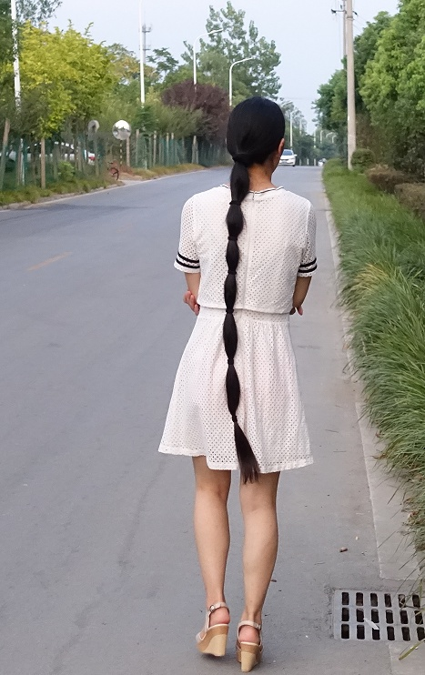 longhair girl walked on the way