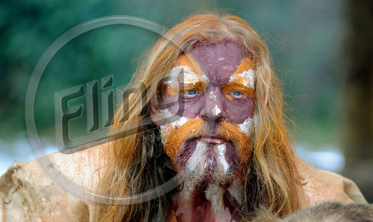 Prehistoric Man with Painted Face.