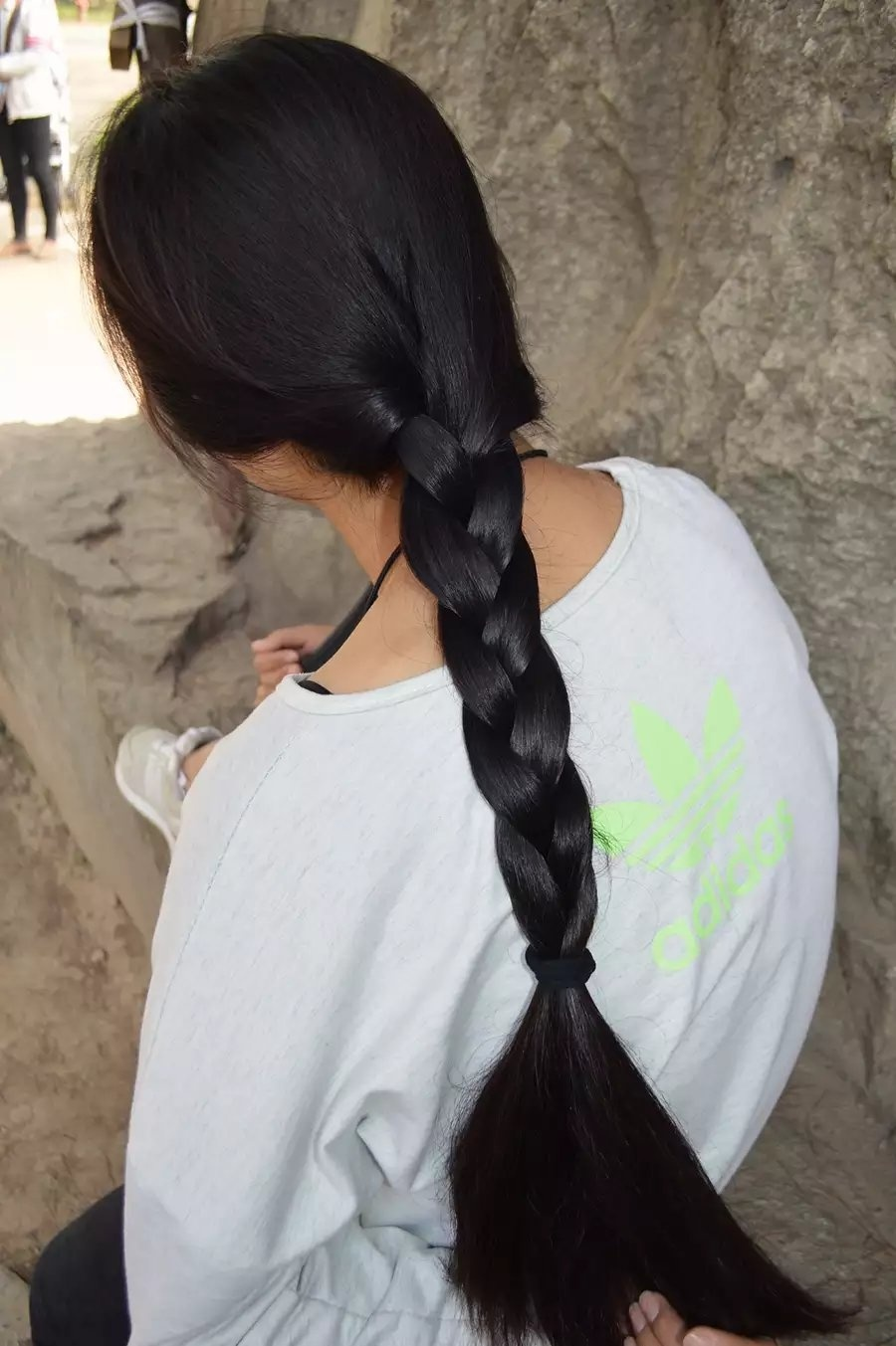 Young girl's longhair cut outside