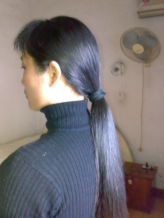 Longhair girl's headshave in her bedroom
