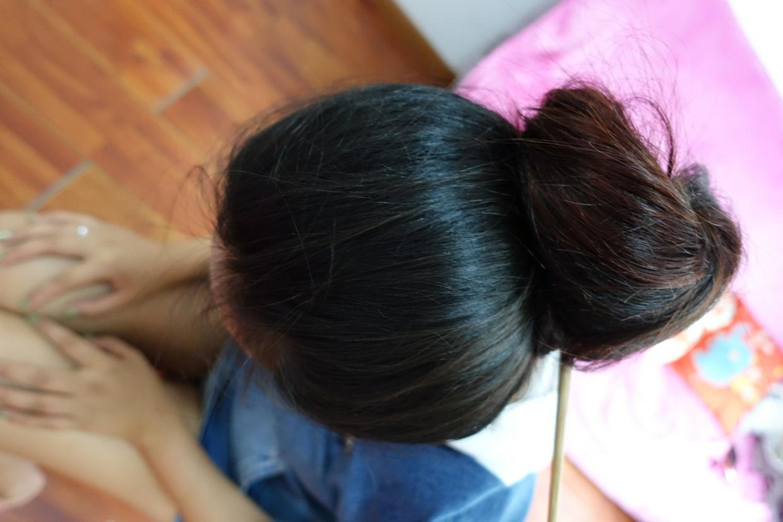Longhair girl's hairplay at home