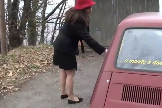 049-2 Vicky cranking an old Fiat 126 WITH FLAT SHOES