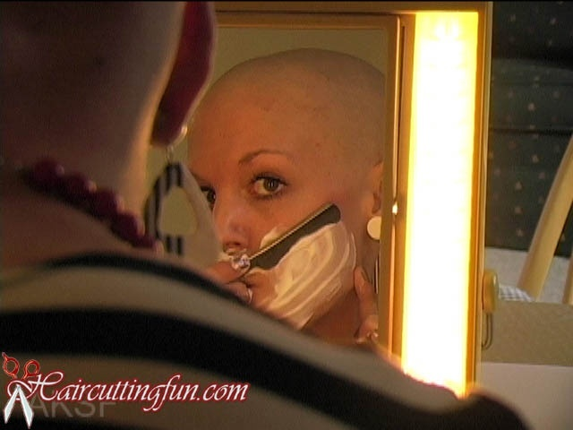 Woman shaving her face straight-edge razor