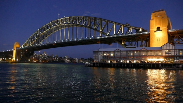 Sydney Harbour Bridge at Night with disappearing Sail Boat - Video Loop or motion Background