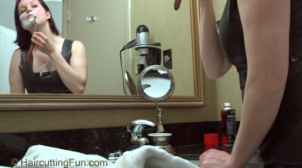 Kat Shaves Her Face in a Black Rubber Dress - VOD Download Video on Demand