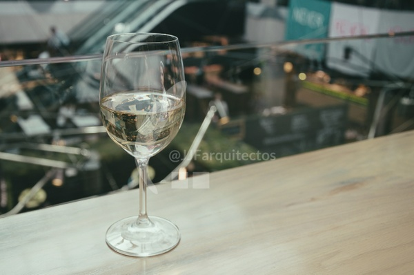 A glass of chardonnay in the bar of a shopping center