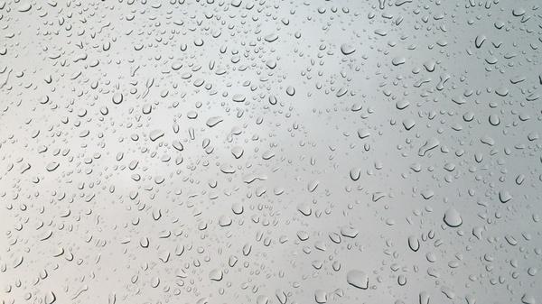 Dark skies with Rain running down Window - Motion Video Background - $7.95